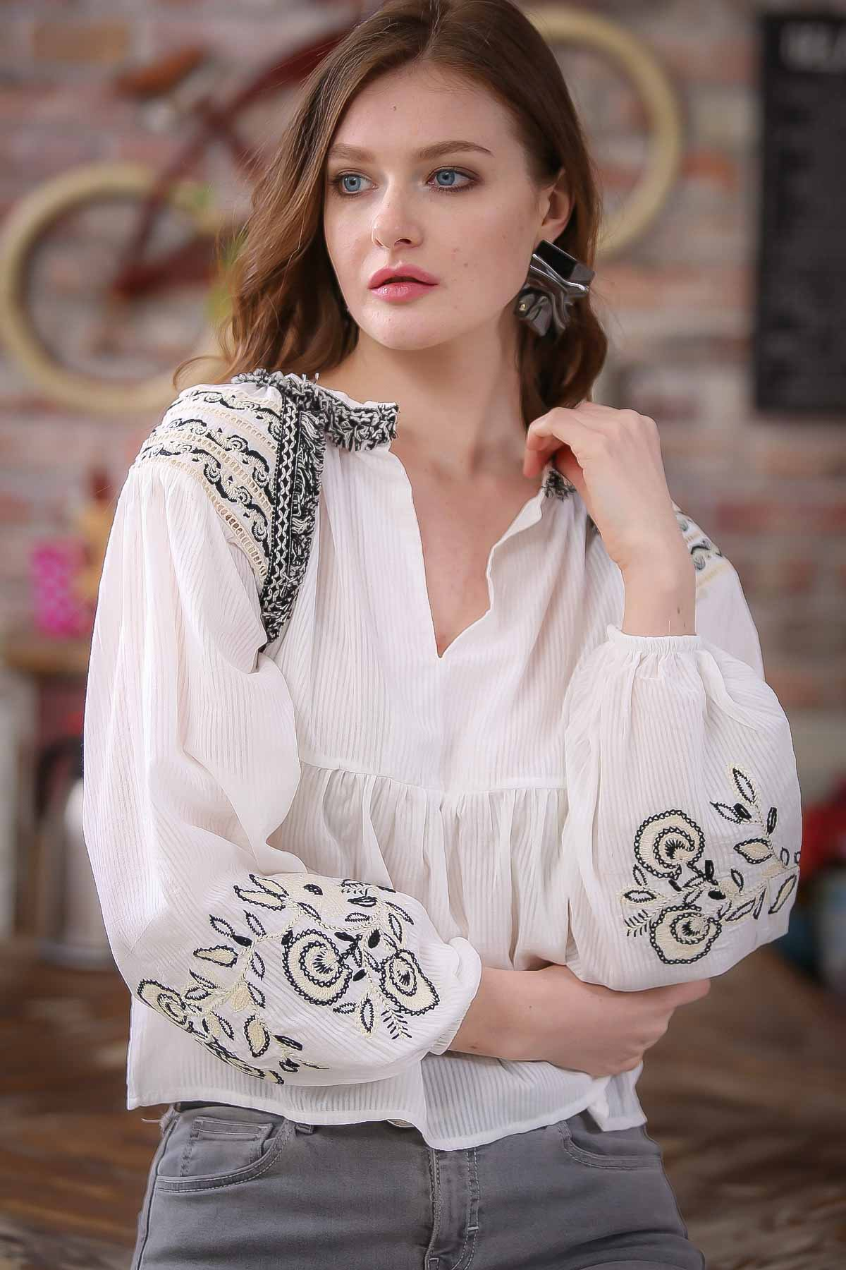 Embroidery detailed tie neck blouse