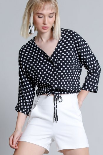 Woven crop blouse in polka dot design with bow and pocket detail